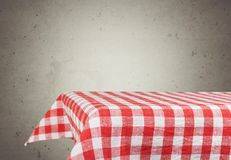 Red cloth napkin on table top. Red cloth napkin table green background design Royalty Free Stock Photos