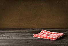 Red cloth napkin on wooden table. Red cloth napkin table green background design Stock Photos