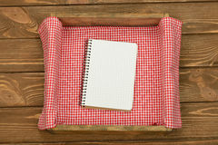Red cloth and notebook Stock Photos