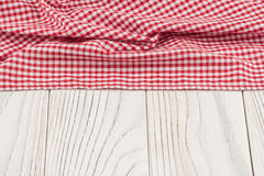 Red cloth on old white wooden table. Royalty Free Stock Photo