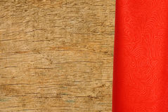 Red cloth over wooden texture close-up Royalty Free Stock Image