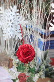 Red cloth rose. Vibrant red cloth rose display in shop window Stock Photography