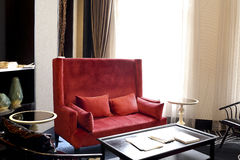 Red cloth sofa, cushion and cushion for leaning on Stock Photos