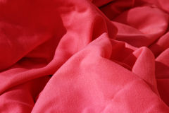 Red cloth table napkins clumped up and wrinkled Royalty Free Stock Images