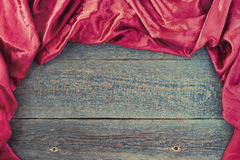 Red cloth on a wooden board Stock Images