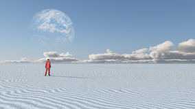 Red Clothed Figure Stands in Empty Desert. Red Clothed Figure Stands in Empty Desolate Desert on terraformed Luna or with earth like planet beyond Royalty Free Stock Photography
