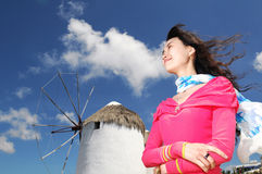 Red Clothers Woman. A confidence woman face to wind Stock Photography