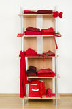Red clothes nicely arranged on a shelf. Royalty Free Stock Images