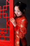 A red clothing girl of China. Stock Photos