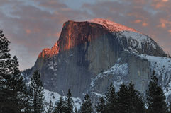 Red clouds over Half Dome at sunset,  Yosemite National Park Royalty Free Stock Photo
