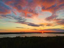 Red clouds on sunset. Sunset view with red spring cloudy skies to Yunyolovskiy reserve stock image