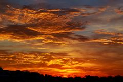 Red, cloudy sky at sunset. Sunset red sky cloud cloudscape Royalty Free Stock Images