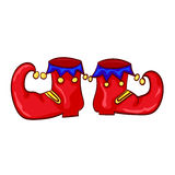 Red clown shoes with bells  on white background. Royalty Free Stock Photography