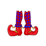 Red clown shoes and legs  on white background. Royalty Free Stock Photography