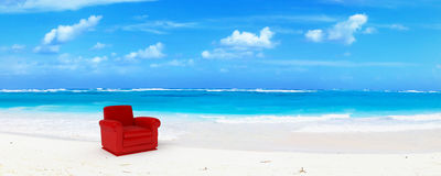 Red club leather sofa in paradise
