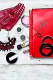 Red clutch bag and ladies accessories Stock Images