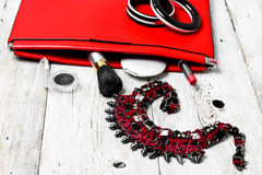 Red clutch bag and ladies accessories Royalty Free Stock Photos
