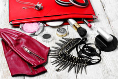 Red clutch bag and ladies accessories Stock Photos