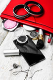 Red clutch bag and ladies accessories Stock Photography