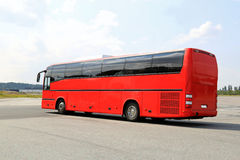 Red Coach Bus Departs for Journey Royalty Free Stock Photo