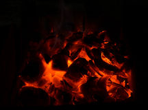 Red coals in the hearth. Coals in the hearth royalty free stock photo