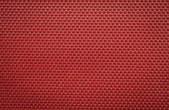 Red coarse canvas background Stock Image