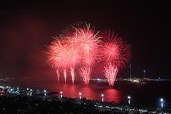 Red coastal firework display. Symbolizing New Year, celebration and pyrotechnics Royalty Free Stock Images