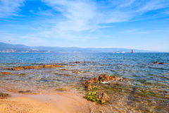 Red coastal stones on public beach of Ajaccio Royalty Free Stock Photography