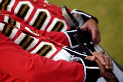 Red Coat. Men dressed in traditional British soldier uniforms and weaponry Stock Photos