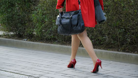 Red coat and high heals Stock Image