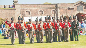 Red coat soldiers at Fort George. 'The celebration of the Centuries' ; Red coat soldiers taking part in the re-enactment organized by Historic Scotland held at Royalty Free Stock Image