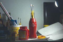 Red Coca Cola Bottle Holding Paintbrushes Royalty Free Stock Photo