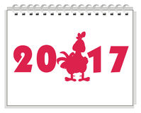 Red cock on calendar. Red solid cock stand next tot the white numbers 2017 on calendar Stock Images