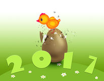 Red cock, symbol of 2017. Red cock, symbol 2017, on the broken egg Stock Image