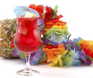 Red Cocktail. Set against a colorful lei and a pineapple Stock Photography