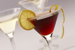 Red cocktail. With lemon and sugar decoration stock photography