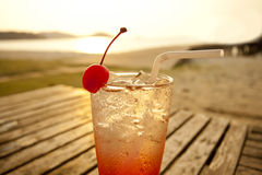 Red cocktail on beach Royalty Free Stock Photography