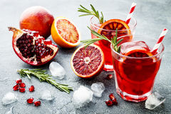 Red cocktail with blood orange and pomegranate. Refreshing summer drink. Holiday aperitif for Christmas party.