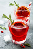 Red cocktail with blood orange and pomegranate. Refreshing summer drink. Holiday aperitif for Christmas party. Red cocktail with blood orange and pomegranate stock photo