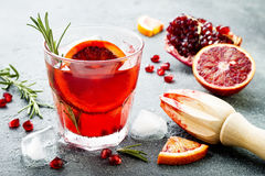Red cocktail with blood orange and pomegranate. Refreshing summer drink. Holiday aperitif for Christmas party. Red cocktail with blood orange and pomegranate royalty free stock images
