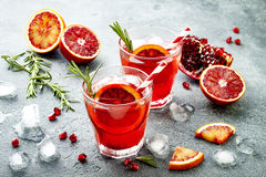 Red cocktail with blood orange and pomegranate. Refreshing summer drink. Holiday aperitif for Christmas party. stock images