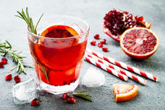 Red cocktail with blood orange and pomegranate. Refreshing summer drink. Holiday aperitif for Christmas party. Red cocktail with blood orange and pomegranate stock photos