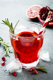 Red cocktail with blood orange and pomegranate. Refreshing summer drink. Holiday aperitif for Christmas party. Red cocktail with blood orange and pomegranate stock image