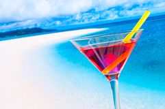 Red cocktail on blur beach with space for text Stock Photos