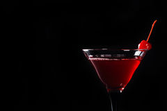 Red cocktail with cherry. Isolated on the black background Stock Photography
