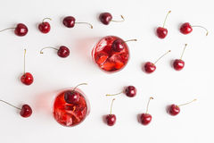 Red cocktail with cherry. On the wooden background Stock Photography