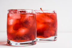 Red cocktail with cherry. On the wooden background Stock Image