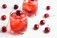 Red cocktail with cherry. On the wooden background Royalty Free Stock Photo