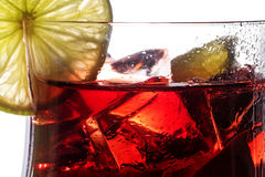 Red cocktail, closeup of a fresh mixed drink from berries, cherr Stock Photos