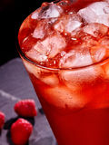 Red cocktail  on dark background Royalty Free Stock Photos